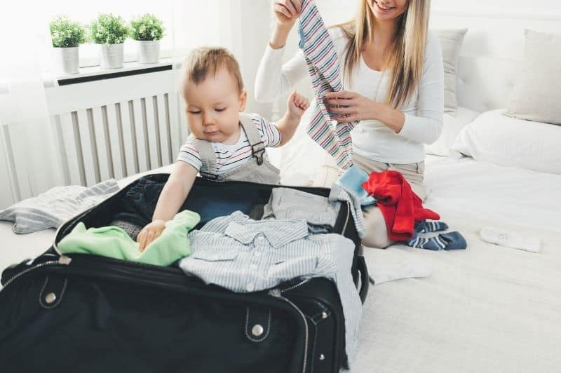 mom and baby packing to travel