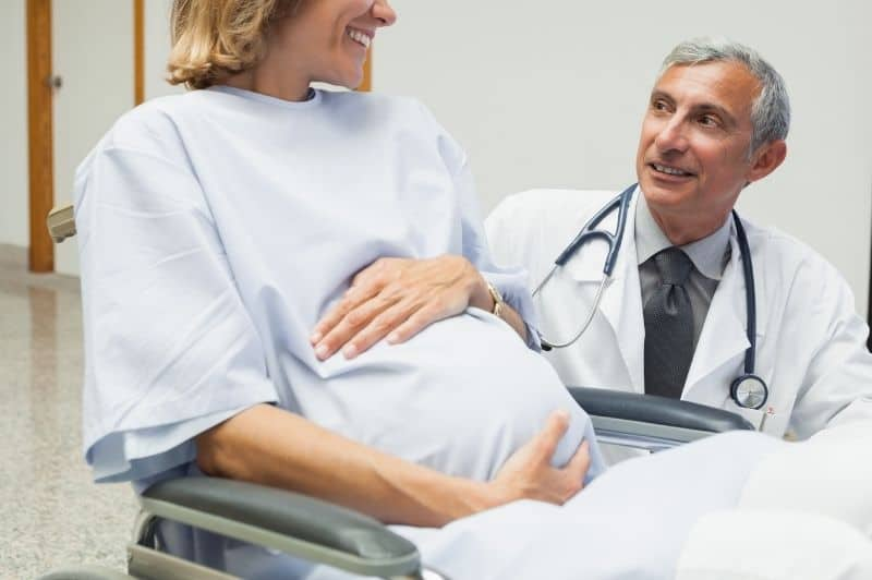 pregnant talking to a doctor
