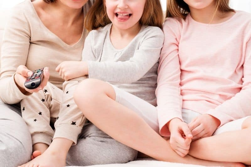 mom and daughters watching movie